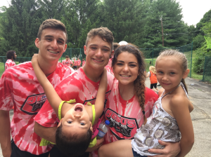Trent Line '17, Sam Bolin '17, and volunteer Gracie DeHaven '17 with some kids at the camp.