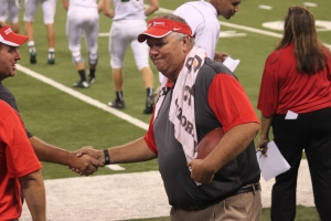 Football Head Coach Moore shakes hands with his congratulators after his 200th win.