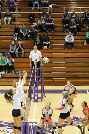 Macey Carrabine goes up for the kill during the semi state championship game against Cathedral.