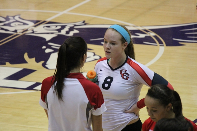 Macey Carrabine listens to advice from Assistant Coach Katie Daprile during a timeout in the third set. Center Grove won the third set 25-19, which was only the 9th set Cathedral dropped all year.