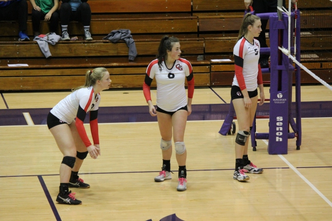 Ellen LeMasters, Taylor Hammill and Madison Smeathers wait for the Cathedral serve during the fifth set. Center Grove fell to No. 1 Cathedral 3-2 in the semi state championship game.