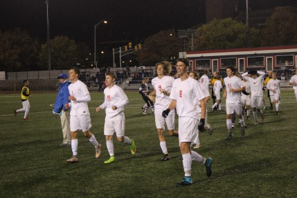 Keaton Radecki, John Nystrom, Andrew Vidal and Griffin Smith lead the team to celebrate with fans.