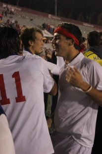 Jesse Sherman and Tye Thixton share hug after the boys soccer team clinched the first state championship in school history.