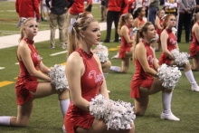 "The Dance Team takes a knee when a Penn player is injured. ""I am so excited to finish out the senior year with an undefeated season. It is incredible, I am so proud of the boys and everybody who worked so hard,"" senior dancer Katie Swaney said. ""I am so excited!"""