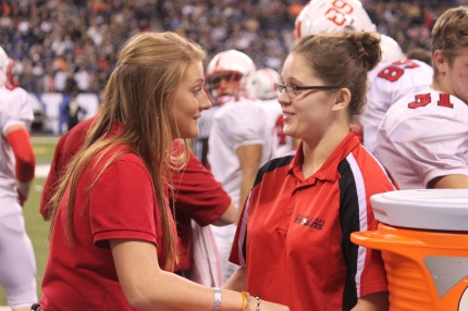 """Vanessa Kuechler and Marina Dietel support the team with drinks. The trainers and managers helped the football team throughout their season and are proud and excited with their victory. """"With all the work that these guys have put in, they have really really paid off. This is the moment that we have been dreaming for."""" trainer Angela Fields said. """"I have been so proud to work with these guys for three years, it has just been amazing how I have watched these guys grow up and win state."""""""