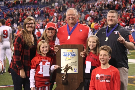 The Moore family celebrates after the game. CG ended their undefeated season with a 28-16 win at Lucas Oil Stadium.