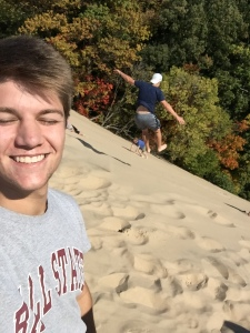 Seth Piercefield and friend in the sand dunes
