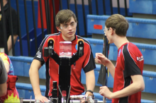 Max Newport and Cory Snyder watch over the robot while they prepare for the next match.
