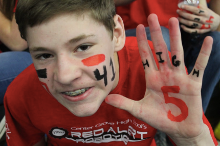 Reis Simpson gets his face and hands painted to show team support and to get high fives!