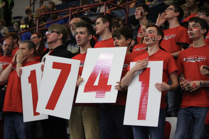 When their robot is on the field, Red Alert stands and cheers for their team and their alliances. The members show support by holding up their team number, 1741.