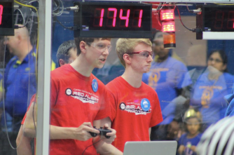 Cory Snyder and Connor Osborne in deep focus while they drive the Robot in one of Red Alert's matches.