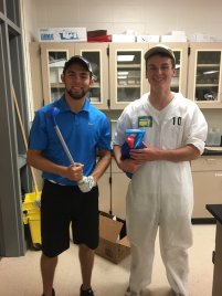 Kyle Parry and Nick Stark reenact Caddyshack as a golfer and his caddy in Mr. Kominowski's classroom for career day.