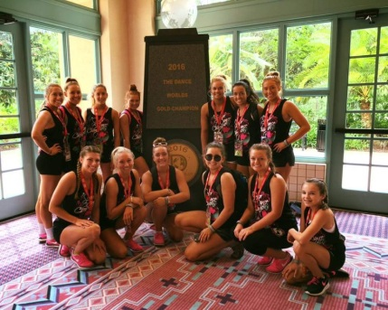 Before a morning practice, the girls pose in front of the Dance Worlds Championship's trophy.