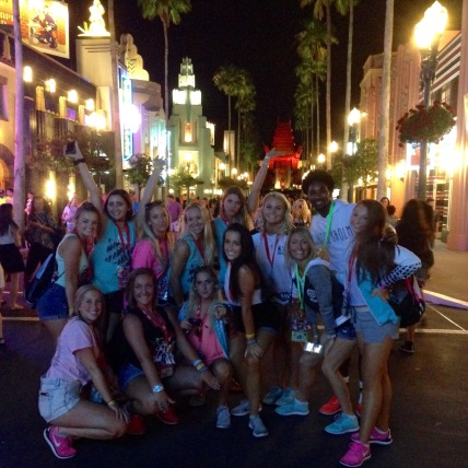 The team celebrates a successful weekend with their coaches in Hollywood Studios.