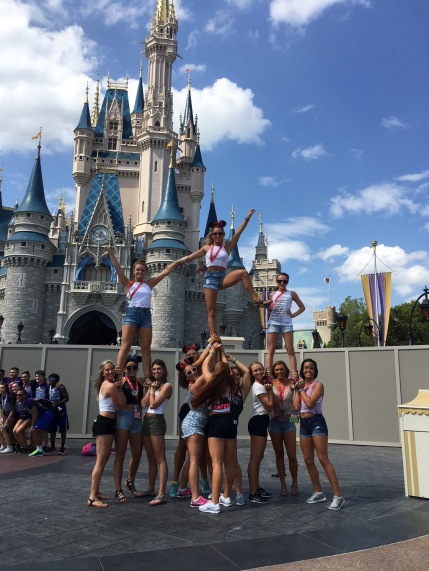 The team snaps a picture in a pyramid in front of the castle.