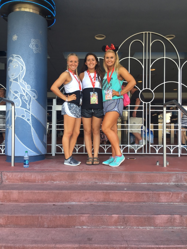 Gwen Feldmeyer, Paxton Welton, and Danielle Petty take a picture outside of the Frozen Singalong in Hollywood Studios.