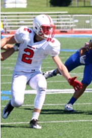 Jake Keith covers the wide receiver in the game against Carmel.