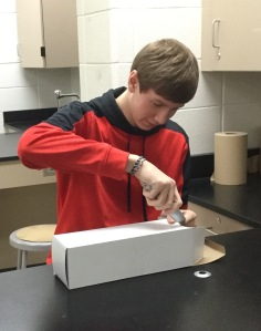 """Junior Cory Snyder works on constructing his device. """"My design was really simple, so it was fast to build,"""" he said. """"I was able to test it for the rest of the period in different scenarios."""""""
