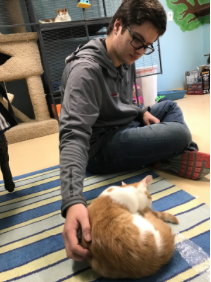 Junior Colin Scifres isn't able to cuddle up with the pets, due to his allergies.