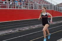 Elena Rodriguez '22 makes her way to the finishes the second leg of the 4x400 meter relay. CG won the relay in 4:34.7.