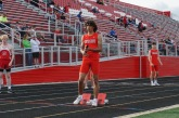 Andreus Mulldore '22 stands watching the starter at his blocks before the 4X400 meter relay.