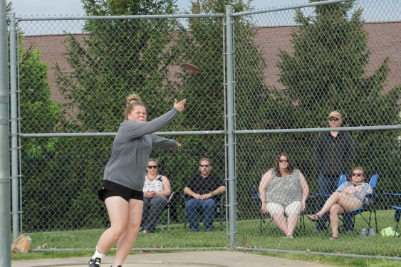 Ella Rasche '21 sends the discus flying, winning the event with a throw of 93 feet.