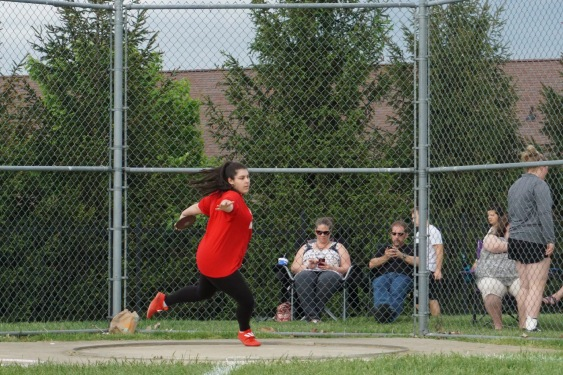 "Kennedy Roberts '19 spins while throwing discus. Though she didn't place in discus, Roberts placed third in shot put with a throw of 27'2""."