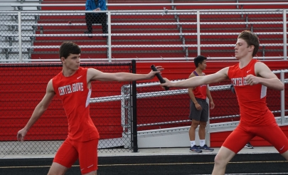 Harrison Roberts '21 and Trent Veith '21 make the first handoff in the 4X400 meter relay.