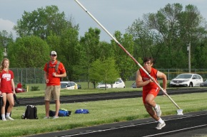 Connor Burries '22 runs down the runway while competing in pole vault. Burries won the event with a jump of 10 feet.